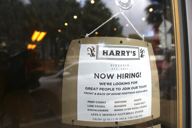FILE - In this Nov. 6, 2019, file photo, a sign advertises job opportunities at Harry's Pizzeria in the Coconut Grove neighborhood in Miami. On Friday, Jan. 17, 2020, the Labor Department reports on job openings and labor turnover for November. (AP Photo/Lynne Sladky, File)