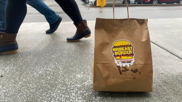 A bag of MrBeast burgers, delivered to the parking lot of the Town Center Barnes & Noble in Virginia Beach, Va., in January 2021. MrBeast is not a traditional restaurant, in the sense that you can't actually go there. They also lack so much as a phone number. The burger spot instead has a shadowy and somewhat tenuous existence: findable only on delivery apps, and only if your address happens to fall within the delivery radius. (Matthew Korfhage/The Virginian-Pilot via AP)