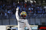 Mercedes driver Lewis Hamilton, of Britain, waves to fans after the qualifying session for the Formula One Brazil Grand Prix at the Interlagos race track in Sao Paulo, Brazil, Saturday, Nov. 16, 2019. (AP Photo/Nelson Antoine)