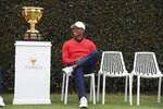 USA team captain Tiger Woods waits for a photo shoot ahead of the President's Cup Golf tournament in Melbourne, Australia, Wednesday, Dec. 11, 2019. (AP Photo Andy Brownbill)