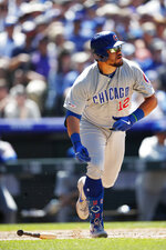 Chicago Cubs' Kyle Schwarber follows the flight of his sacrifice fly to drive in a run off Colorado Rockies relief pitcher Jake McGee in the fifth inning of a baseball game Wednesday, June 12, 2019, in Denver. (AP Photo/David Zalubowski)