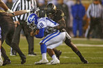 Wake Forest linebacker Ja'Cquez Williams tackles Duke quarterback Quentin Harris (18) in the first half of an NCAA college football game in Winston-Salem, N.C., Saturday, Nov. 23, 2019. (AP Photo/Nell Redmond)