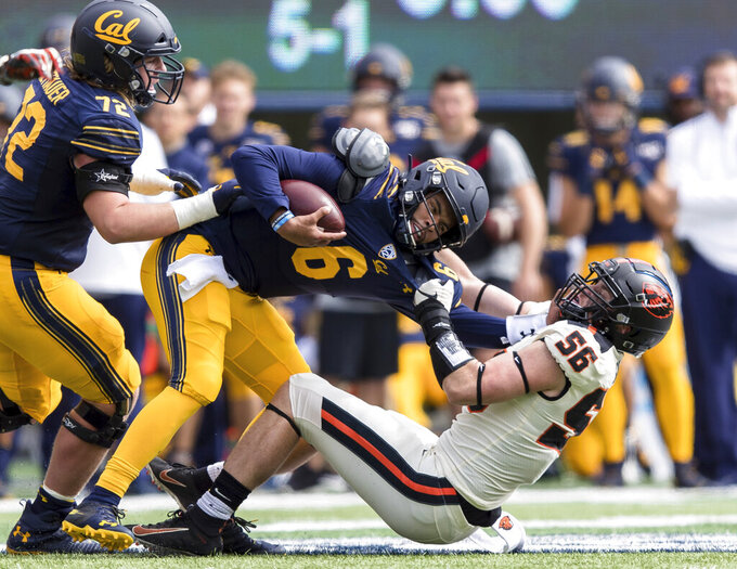 California quarterback Devon Modster (6) is sacked by Oregon State  linebacker Devon Modster (56) in the second quarter of an NCAA college football game in Berkeley, Calif., Saturday, Oct. 19, 2019. (AP Photo/John Hefti)