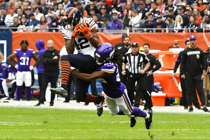 Chicago Bears wide receiver Allen Robinson (12) catches a pass as Minnesota Vikings cornerback Trae Waynes defends during the first half of an NFL football game Sunday, Sept. 29, 2019, in Chicago. (AP Photo/Matt Marton)