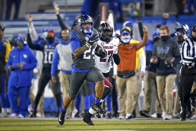 Kentucky running back Chris Rodriguez Jr. (24) runs for a touchdown during the second half of the team's NCAA college football game against South Carolina, Saturday, Dec. 5, 2020, in Lexington, Ky. (AP Photo/Bryan Woolston)