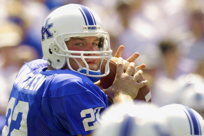 FILE - In this Sept. 7, 2002, file photo, Kentucky quarterback Jared Lorenzen looks downfield for a receiver during the first half of the team's NCAA college football game against UTEP in Lexington, Ky. Lorenzen, a husky left-handed quarterback who set multiple Kentucky passing and offensive records before backing up Eli Manning on the New York Giants' Super Bowl-winning 2007 team, has died. He was 38. A release from the school said Lorenzen's family announced his death on Wednesday. (AP Photo/Ed Reinke, File)