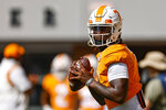 Tennessee quarterback Joe Milton III (7) looks for a receiver during warmups before an NCAA college football game against Pittsburgh Saturday, Sept. 11, 2021, in Knoxville, Tenn. (AP Photo/Wade Payne)
