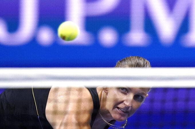Karolina Pliskova, of the Czech Republic, eyes her return to Maria Sakkari, of Greece, during the quarterfinals of the U.S. Open tennis tournament Wednesday, Sept. 8, 2021, in New York. (AP Photo/Frank Franklin II)
