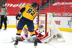 Nashville Predators center Ryan Johansen (92) scores a shootout goal against Detroit Red Wings goaltender Thomas Greiss (29) during an NHL hockey game Tuesday, April 6, 2021, in Detroit. Nashville won 3-2. (AP Photo/Paul Sancya)