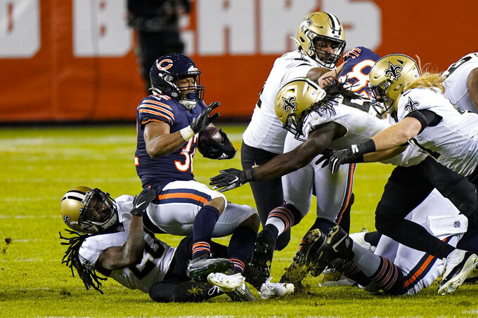 Chicago Bears running back David Montgomery (32) is tackled by New Orleans Saints cornerback Janoris Jenkins (20) in the second half of an NFL football game in Chicago, Sunday, Nov. 1, 2020. (AP Photo/Nam Y. Huh)