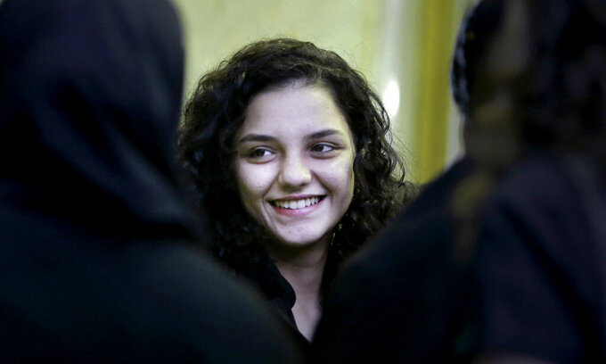FILE - In this Aug. 30, 2014 file photo, Sanaa Seif, the younger daughter of Ahmed Seif, one of Egypt's most prominent civil rights lawyer and campaigner, receives condolences for her father at Omar Makram Mosque after being temporarily released from prison, in Cairo, Egypt. An Egyptian court on Wednesday, March 17, 2021, convicted Seif, a prominent human rights activist, of spreading false news and insulting a police officer, sentencing her to 18 months in prison. (AP Photo/Amr Nabil, File)