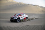 Driver Bernhard Ten Brinke, of Netherlands, and co-driver Xavier Panseri, of France, race their Toyota during the second stage of the Dakar Rally between Pisco and San Juan de Marcona, Peru, Tuesday, Jan. 8, 2019. (AP Photo/Ricardo Mazalan)