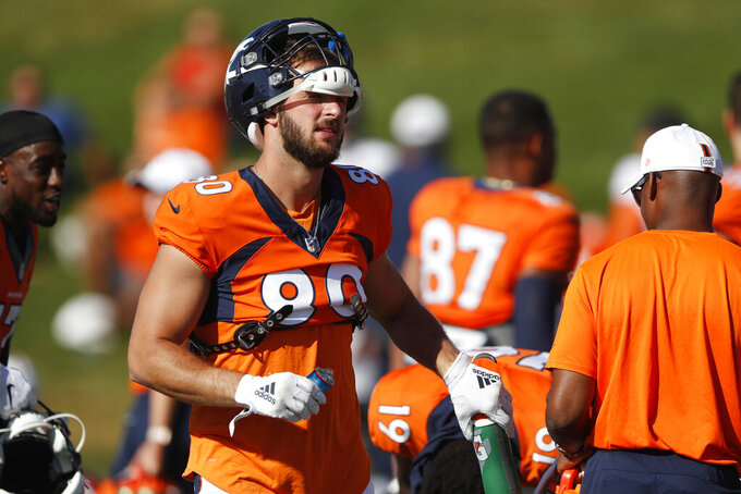 Denver Broncos tight end Jake Butt grabs a water bottle during a combined NFL training camp with the San Francisco 49ers Saturday, Aug. 17, 2019, at the Broncos' headquarters in Englewood, Colo. (AP Photo/David Zalubowski)