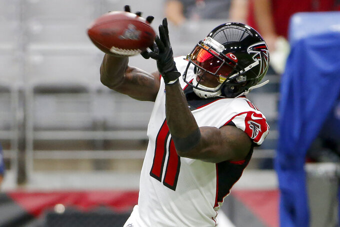 Atlanta Falcons wide receiver Julio Jones (11) warms up prior to an NFL football game against the Arizona Cardinals, Sunday, Oct. 13, 2019, in Glendale, Ariz. (AP Photo/Rick Scuteri)