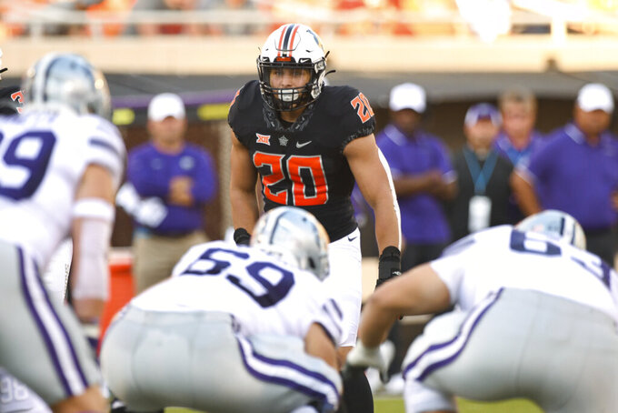 FILE - Oklahoma State linebacker Malcolm Rodriguez awaits the snap during an NCAA college football game against Kansas State in Stillwater, OIkla., in this Saturday, Sept. 25, 2021, file photo. Rodriguez was named the Defensive Player of the Big 12 in the Midseason Awards. (AP Photo/Brody Schmidt, File)
