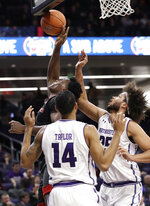 Rutgers center Shaquille Doorson, left, shoots as Northwestern's Ryan Taylor (14) and Barret Benson (25) defend during the first half of an NCAA college basketball game, Wednesday, Feb. 13, 2019, in Evanston, Ill. (AP Photo/Nam Y. Huh)