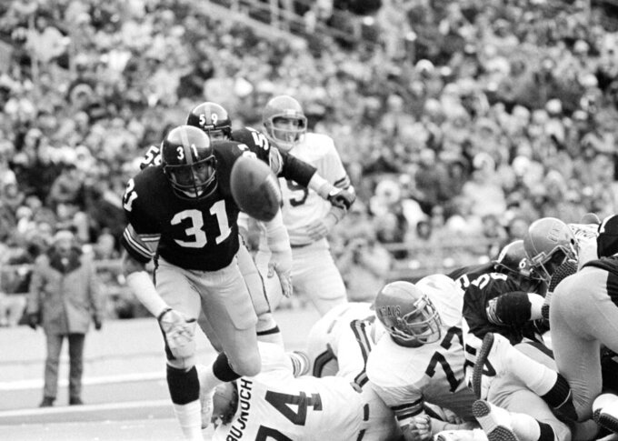 FILE - Pittsburgh Steelers Donnie Shell (31) eyes a loose ball after a fumble in the end zone by Cincinnati Bengals' Pete Johnson, not shown, during fourth quarter action in Pittsburgh, in this Dec. 3, 1979, file photo. Steelers' Ron Johnson recovered the fumble. Shell views his winding path to football immortality as a testament to what can happen when innate ability and a relentless belief in yourself collide. (AP Photo/Charles Kenneth Lucas, File)