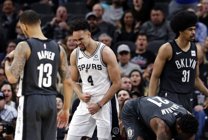 San Antonio Spurs guard Derrick White (4) reacts after he was fouled while scoring late in the the second half of an NBA basketball game against the Brooklyn Nets in San Antonio, Thursday, Jan. 31, 2019. San Antonio won 117-114. (AP Photo/Eric Gay)