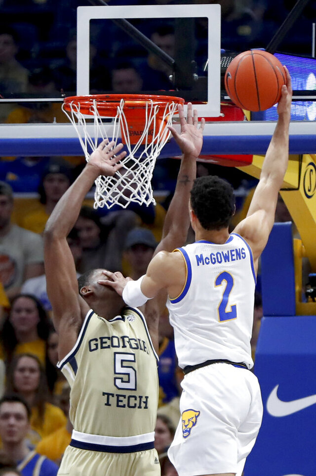 Pittsburgh's Trey McGowens (2) pushes Georgia Tech's Moses Wright (5) as he shoots during the first half of an NCAA college basketball game, Saturday, Feb. 8, 2020, in Pittsburgh. (AP Photo/Keith Srakocic)