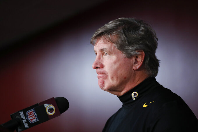 Washington Redskins interim head coach Bill Callahan pauses while speaking during a news conference following an NFL football game against the Philadelphia Eagles, Sunday, Dec. 15, 2019, in Landover, Md. Eagles won 37-27.(AP Photo/Alex Brandon)