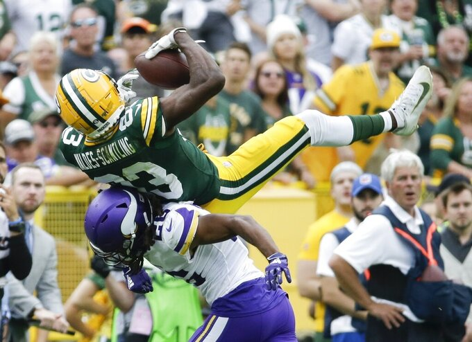 Minnesota Vikings' Trae Waynes breaks up a pass intended for Green Bay Packers' Marquez Valdes-Scantling during the second half of an NFL football game Sunday, Sept. 15, 2019, in Green Bay, Wis. (AP Photo/Mike Roemer)
