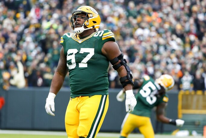 Green Bay Packers' Kenny Clark celebrates after a sack during the first half of an NFL football game against the Washington Redskins Sunday, Dec. 8, 2019, in Green Bay, Wis. (AP Photo/Matt Ludtke)