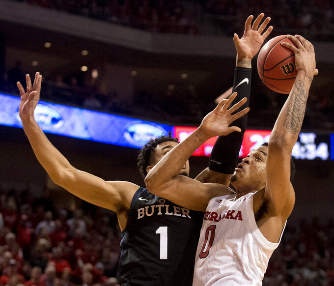 Nebraska guard James Palmer Jr. (0) has the ball stripped by Butler's Jordan Tucker (1) during the first half of an NCAA college basketball game in the NIT on Wednesday, March 20, 2019, in Lincoln, Neb. (Francis Gardler/Lincoln Journal Star via AP)