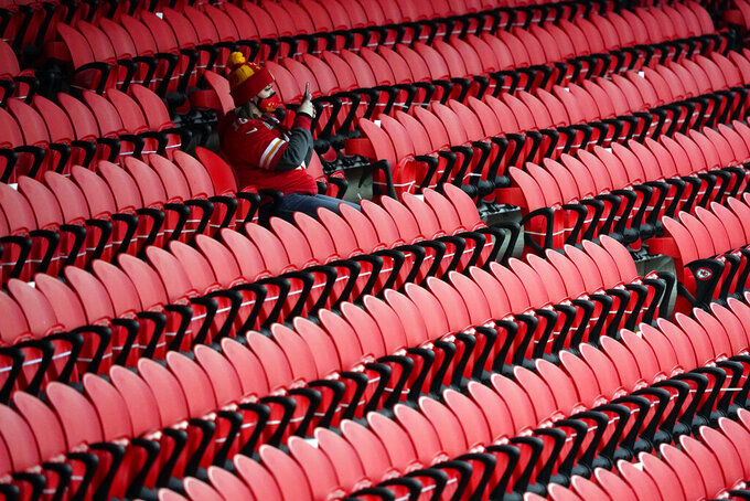 A fan watches players warmup before the AFC championship NFL football game between the Kansas City Chiefs and the Buffalo Bills, Sunday, Jan. 24, 2021, in Kansas City, Mo. (AP Photo/Jeff Roberson)