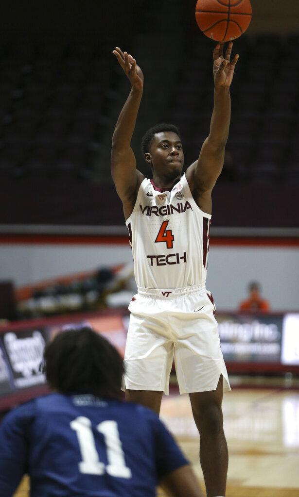 Virginia Tech's Nahiem Alleyne (4) shoots a three-point basket over Longwood's Justin Hill (11) in the first half of an NCAA college basketball game in Blacksburg, Va., Monday, Dec. 21, 2020. (Matt Gentry/The Roanoke Times via AP, Pool)