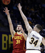 Southern California's Nick Rakocevic, left, shoots against California's Grant Anticevich (34) in the first half of an NCAA college basketball game Saturday, Feb. 16, 2019, in Berkeley, Calif. (AP Photo/Ben Margot)