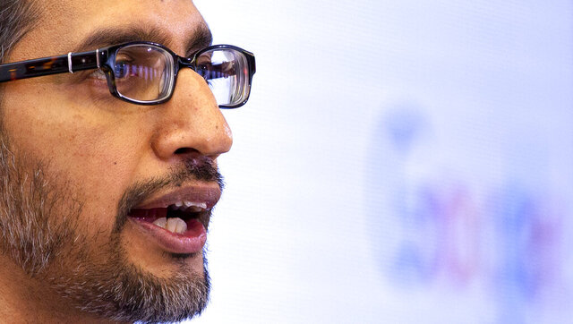 Google's chief executive Sundar Pichai addresses the audience during an event on artificial intelligence at the Square in Brussels, Monday, Jan. 20, 2020. Google's chief executive called Monday for a balanced approach to regulating artificial intelligence, telling a European audience that the technology brings benefits but also negative consequences. (AP Photo/Virginia Mayo)