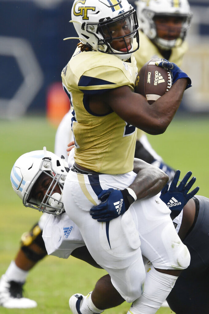 Georgia Tech running back Jordan Mason (27) is hit by Citadel linebacker Willie Eubanks III (9) during the second half of an NCAA college football game, Saturday, Sept. 14, 2019, in Atlanta. The Citadel won 27-24 in overtime. (AP Photo/Mike Stewart)