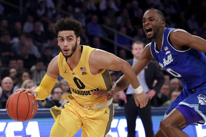 Marquette guard Markus Howard (0) drives against Seton Hall guard Quincy McKnight (0) during the first half of an NCAA college basketball semifinal game in the Big East men's tournament, Friday, March 15, 2019, in New York. (AP Photo/Julio Cortez)