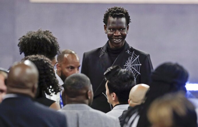 Oregon's Bol Bol smiles before the NBA basketball draft Thursday, June 20, 2019, in New York. (AP Photo/Julio Cortez)