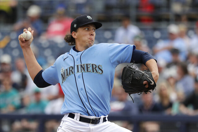 Seattle Mariners starting pitcher Logan Gilbert throws against the Los Angeles Angels in the first inning during a spring training baseball game Tuesday, March 10, 2020, in Peoria, Ariz. (AP Photo/Elaine Thompson)