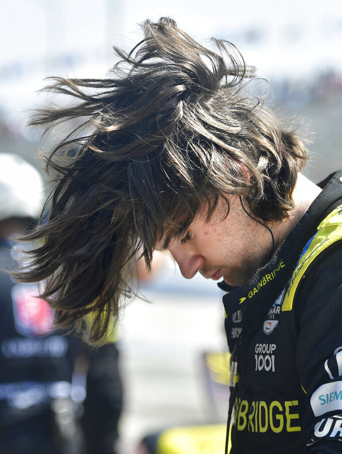 Indycar driver Colton Herta flips his hair after climbing from his race car following qualifying for the Grand Prix of Long Beach auto race Saturday, Sept. 25, 2021, in Long Beach, Calif. (Will Lester/The Orange County Register via AP)