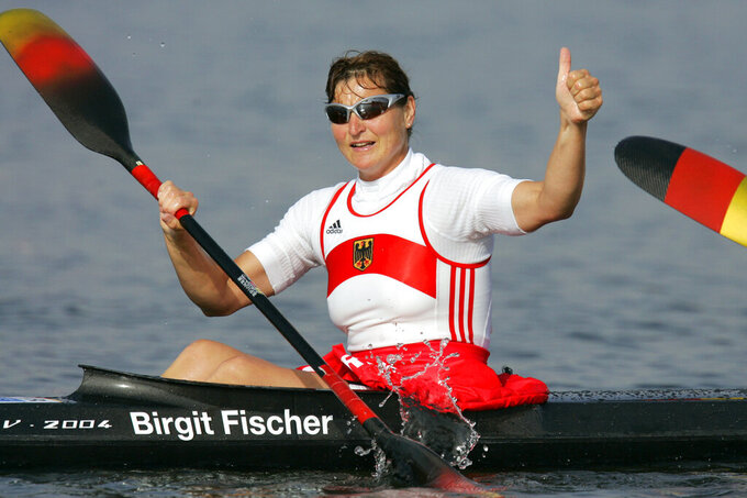 FILE - In this Aug. 27, 2004, file photo, Germany's Birgit Fischer celebrates after she and her teammates won the Women's K4 500 meter final to take the gold medal, during the kayak flatwater event at the 2004 Olympic Games in Schinias near Athens, Greece. (AP Photo/Mark J. Terrill, File)