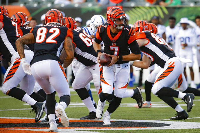 Cincinnati Bengals quarterback Jake Dolegala looks to hand the ball off during the first half of the team's NFL preseason football game against the Indianapolis Colts, Thursday, Aug. 29, 2019, in Cincinnati. (AP Photo/Frank Victores)