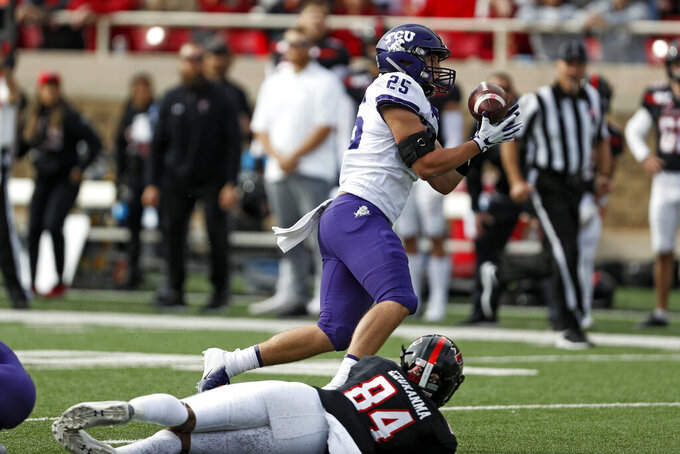 TCU's Wyatt Harris (25) intercepts a pass over Texas Tech's Erik Ezukanma (84) during the first half of an NCAA college football game Saturday, Nov. 16, 2019, in Lubbock, Texas. (Brad Tollefson/Lubbock Avalanche-Journal via AP)