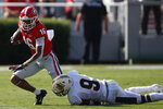 Georgia quarterback John Seter (16) tries to break a tackle from Murray State defensive back Dior Johnson (9) during the first half of an NCAA college football game Saturday, Sept. 7, 2019, in Athens, Ga. (Joshua L. Jones/Athens Banner-Herald via AP)