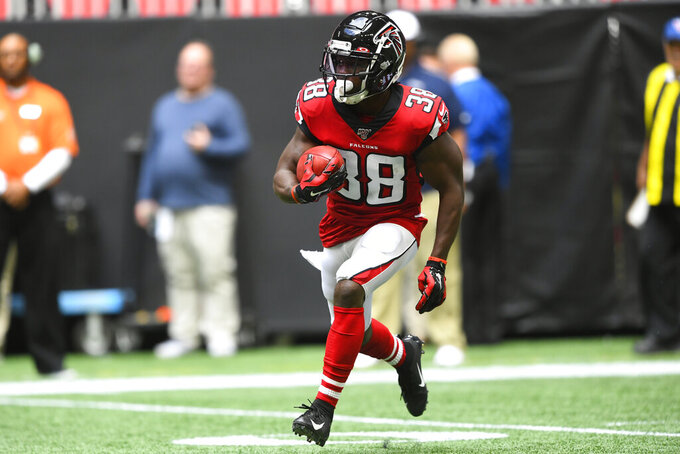 Atlanta Falcons running back Kenjon Barner (38) runs a kickoff return against the Los Angeles Ramsduring the first half of an NFL football game, Sunday, Oct. 20, 2019, in Atlanta. (AP Photo/John Amis)