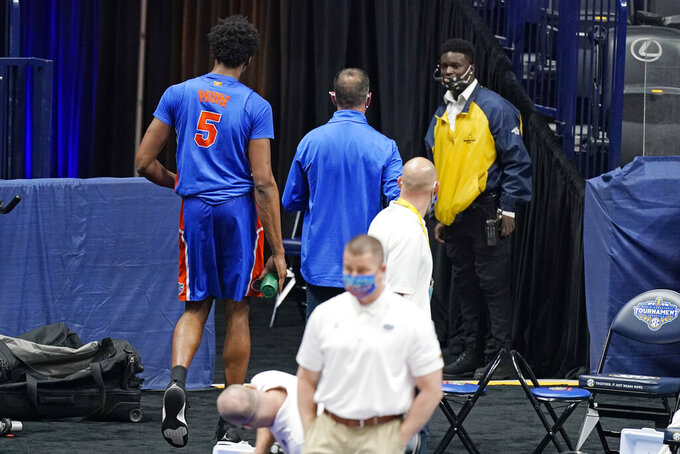 Florida's Omar Payne (5) leaves the court after being ejected in the second half of an NCAA college basketball game against Tennessee in the Southeastern Conference Tournament Friday, March 12, 2021, in Nashville, Tenn. (AP Photo/Mark Humphrey)