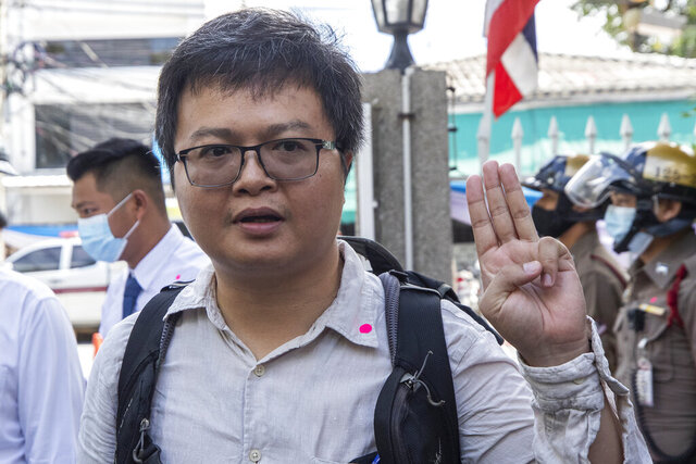 Pro-democracy activist and human rights lawyer Arnon Nampha raises a three-finger salute, a symbol of resistance, as he arrives at the Nangloeng police station in Bangkok, Thailand, Tuesday, Aug, 25, 2020. Four prominent Thai anti-government activists answered a summons at a Bangkok police station on Tuesday, the latest in a series of legal moves by the authorities to clamp down on protests that are the most serious challenge yet to Prime Minister Prayuth Chan-ocha's administration. (AP Photo/Sakchai Lalit)