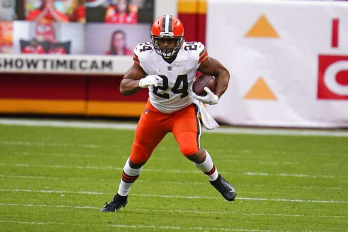Cleveland Browns running back Nick Chubb runs after catching a pass during the first half of an NFL divisional round football game against the Kansas City Chiefs, Sunday, Jan. 17, 2021, in Kansas City. (AP Photo/Jeff Roberson)