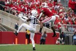 Penn State's Ji'Ayir Brown breaks up a pass intended for ]Wisconsin's Kendric Pryor during the second half of an NCAA college football game Saturday, Sept. 4, 2021, in Madison, Wis. Penn State won 16-10. (AP Photo/Morry Gash)