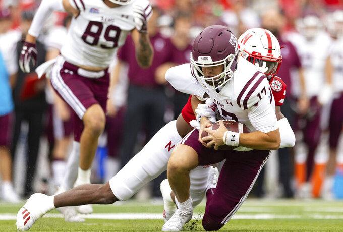 Nebraska's Quinton Newsome, rear, sacks Fordham quarterback Tim DeMorat (17) during the first half of an NCAA college football game Saturday, Sept. 4, 2021, at Memorial Stadium in Lincoln, Neb. (AP Photo/Rebecca S. Gratz)