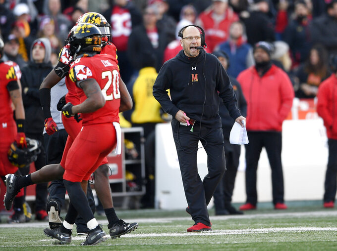 Maryland head coach Matt Canada, right, reacts during the second half of an NCAA football game against Ohio State, Saturday, Nov. 17, 2018, in College Park, Md. Ohio State won 52-51 in overtime. (AP Photo/Nick Wass)