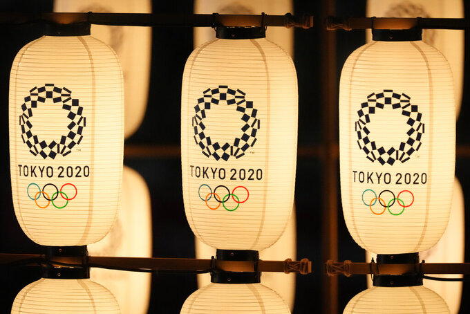 Lanterns illuminated during the opening ceremony in the Olympic Stadium at the 2020 Summer Olympics, Friday, July 23, 2021, in Tokyo, Japan. (AP Photo/Ashley Landis)