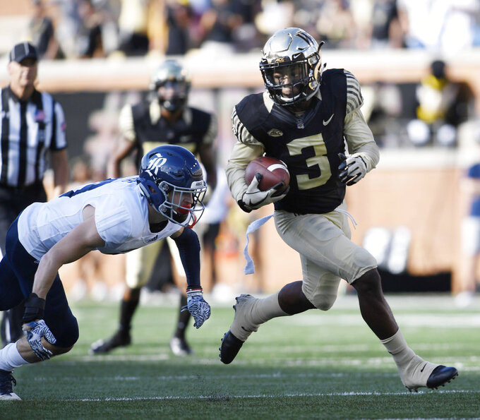 Wake Forest's Greg Dortch (3) finds room to run during the first half of the team's NCAA college football game against Rice on Saturday, Sept. 29, 2018, in Winston-Salem, N.C. (AP Photo/Woody Marshall)