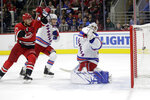 New York Rangers defenseman Adam Fox and goaltender Henrik Lundqvist (30), of Seweden, defend against Carolina Hurricanes right wing Nino Niederreiter (21), of the Czech Republic, while Hurricanes defenseman Dougie Hamilton, not shown, scores during the second period of an NHL hockey game in Raleigh, N.C., Thursday, Nov. 7, 2019. (AP Photo/Gerry Broome)